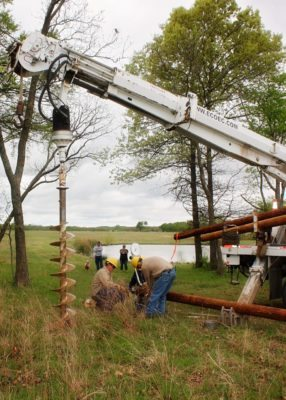 Our crew carefully drilling the hole for the AreaMax. The Smiths decided to place the light near a pond on the property.